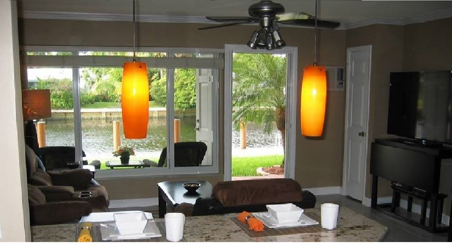 Beautiful view of waterway from kitchen through living room.