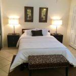 Unit 14 - Beautiful 500 count bedding, queen size bed and closets.  Lights have USB and Power Outlets beside bed.