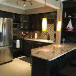 Unit 3 - Newly renovated kitchen and bar with granite countertops and stainless appliances