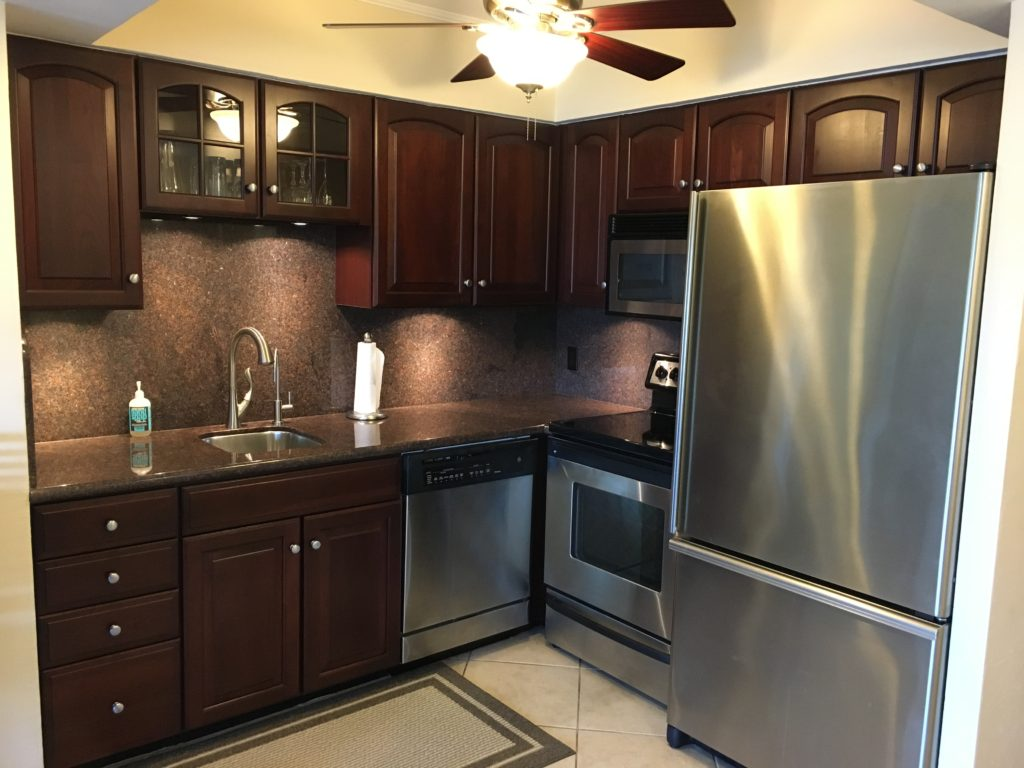 Unit 14 - Updated kitchen with granite counter tops and stainless appliances