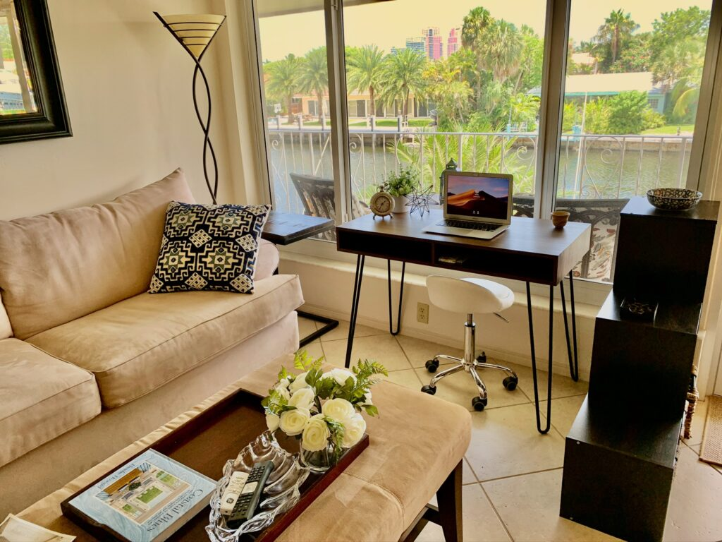Unit 14 - Living room with work desk and view to waterway